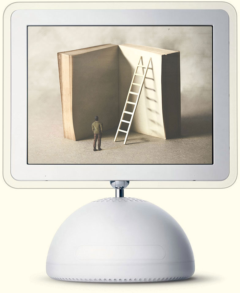 iMac from 2003 with a picture of a man standing next to a giant book with ladder propped up against it.